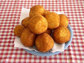 Arancini - Sicilian arancini for sale at a counter