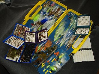 Fly fishing tackle - An assortment of fly boxes with trout, warmwater and saltwater flies