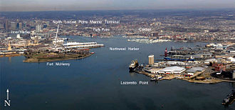 Port of Baltimore - Aerial view – looking up the Northwest Branch of the Patapsco River towards the Inner Harbor and downtown Baltimore. Historic Fort McHenry from the War of 1812 is on Locust Point / Whetstone Point is at center left.