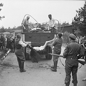 Josef Kramer - Former guards at Bergen-Belsen are made to load the bodies of dead prisoners onto a truck for burial, 17–18 April 1945