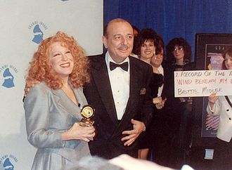 "Bette Midler discography - Bette Midler on February 21, 1990, along with producer Arif Mardin, after winning two trophies at the 32nd Grammy Awards for the Record and the Song of the Year — ""Wind Beneath My Wings""."