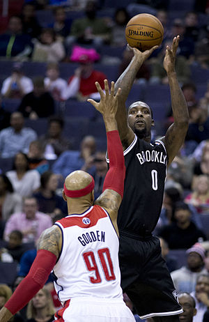Andray Blatche - Blatche taking a jump shot over Drew Gooden.