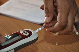 Blood glucose testing by blood glucose meter.