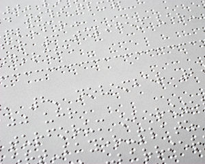 Optical braille recognition - Image of a page showing both the raised braille characters, and the recessed characters on the other side of the page.