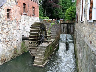 structure that uses a water wheel or turbine to drive a mechanical process