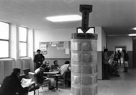 A government unemployment office with job listings, West Berlin, West Germany, 1982. Bundesarchiv B 145 Bild-P109961, Berlin, Arbeitsamt Sonnenallee, Arbeitslose.jpg
