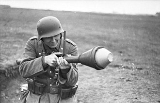 Panzerfaust - A Wehrmacht Gefreiter aims the Panzerfaust using the integrated leaf sight