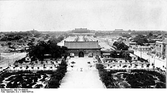 "Tiananmen Square - Tiananmen Square in the early 20th century, viewed from Zhengyangmen Gate (Qianmen Gate) with the Gate of China, later removed in 1954, in the place of the present-day Mao Zedong Mausoleum. The ""corridor of a thousand steps"" is visible behind the Gate of China, and Tiananmen Gate is in the distance."
