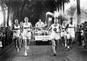 1936 Summer Olympics - Runners carrying the Olympic Flame