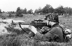 StG 44 - A soldier demonstrates the transitional MP 43/1 variant, used to determine the suitability of the rifle for sniping purposes, October 1943. The rifle is fitted with a ZF 4 telescopic sight.