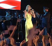 "Dion singing ""God Bless America"" at a May 2, 2002 concert aboard the USS Harry S. Truman."