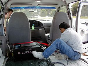 Portable emissions measurement system - A CATI PEMS being strapped down inside a vehicle