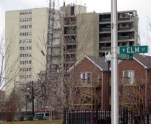"Cabrini–Green Homes - Newly built housing sharply contrasts with William Green Homes, under demolition in 2005. This is the demolition of 714 West Division Street, nicknamed ""Goldmine""."