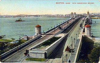 Red Line (MBTA) - The new Cambridge (now Longfellow) Bridge pre-1912, viewed from the Boston end, with an unfinished heavy rail right-of-way down its center. Tracks visible at the sides are for streetcars.