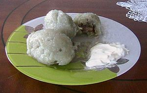Culture of Lithuania - Cepelinai served with sour cream
