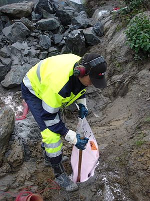 ANFO - Charging a hole with ANFO for rock blasting