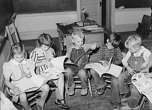 Children looking at picture books at school, S...