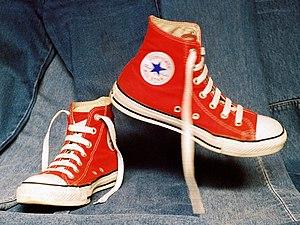 Red Chuck Taylor All Star basketball shoe.