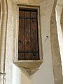 Corby Glen St John's - rood screen door above the pulpit.jpg