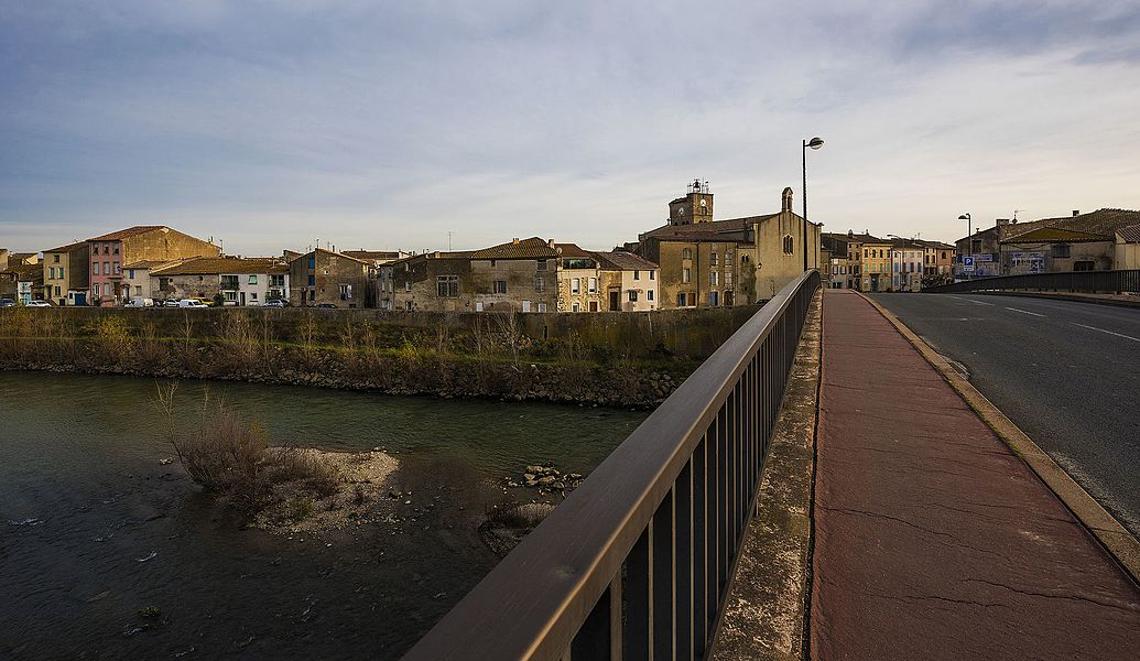 Revolution Embankment from the bridge over the Aude River. Coursan, Aude, France.