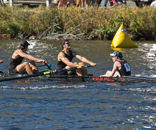 A coxswain (far right) sitting in the stern of the boat, facing the rowers, at the Head of the Charles Regatta. Coxswain HOC 1.jpg