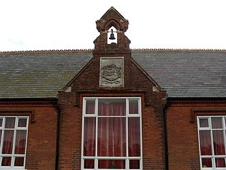 Bawdeswell - Crest on the bell tower of Bawdeswell School