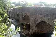 Old stone bridge with pedestrian refuges over River Culm at Culmstock