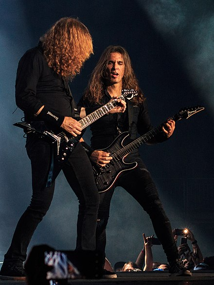 Kiko Loureiro (right) playing live with Dave Mustaine in 2018. Dave Mustaine and Kiko Loureiro live in London 2018-06-16.jpg
