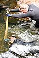 David Stricklet holds a rock for Ed Williams (9667526036).jpg