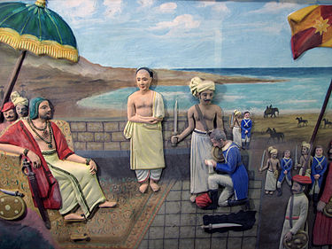 Eustachius De Lannoy of the Dutch East India Company surrenders to Maharaja Marthanda Varma of the Indian Kingdom of Travancore after the Battle of Colachel. (Depiction at Padmanabhapuram Palace) De Lannoy Surrender.JPG