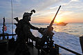 Defense.gov News Photo 120313-N-YO394-161 - A U.S. Navy sailor assigned to Riverine Squadron 2 mans a .50-caliber machine gun aboard a Riverine Command Boat off the coast of Virginia during a.jpg
