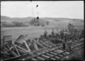 Derailed wagons after a railway accident at Ruatangata near Whangarei, 1923. ATLIB 293677.png