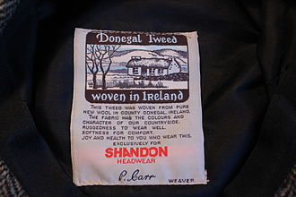 Donegal tweed - Donegal Tweed Label in a flat cap.