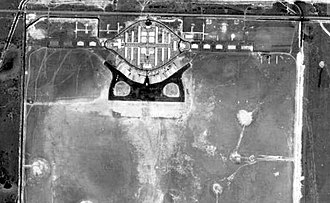 Dorr Field - Aerial photograph of Dorr Field, Florida, 1942. Note the World War I layout of buildings and hangars along the top of the photo; the World War II expansion of the facility into a flight training school in the center. Several World War I hangars remain along with the new hangars built as part of the Emory-Riddle Flight School in the center. The large, grassy flying field remains