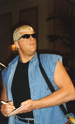 Goldust - Rhodes signing autographs, without his face paint.