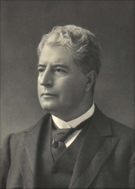 Black and white head and shoulders photograph of well-dressed man