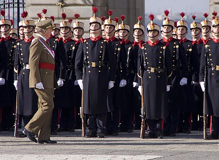 King Juan Carlos I inspects the Royal Guard during the 2009 Pascua Militar. El rey Juan Carlos I en la Pascua Militar de 2009.jpg