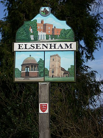 Elsenham - The village sign: the top section depicts Elsenham Hall; the bottom sections show St. Mary's Church and The Pump.