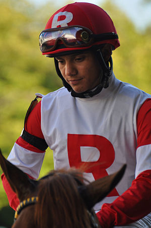 Elvis Trujillo - Monmouth Park in August 2011 with the Kenneth L. Rammsey Silks.
