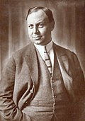 Black and white portrait of Emil Jannings--a corpulent white man of middle-age with short hair brushed to one side, wearing a sophisticated suit--in 1926.