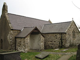 St Iestyn's Church, Llaniestyn - The west and south sides of the church – the old door (far left) and the newer porch (centre) can be seen.