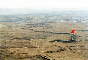 Exhumed river channel - An exhumed river channel (red arrow) in the Cedar Mountain Formation near Green River, Utah