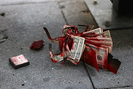 Expended dye pack after a Los Angeles area Bank of America robbery, January 2, 2008. This particular pack was concealed inside a stack of twenty-dollar bills. Exploded dye pack after Bank of America robbery.jpg
