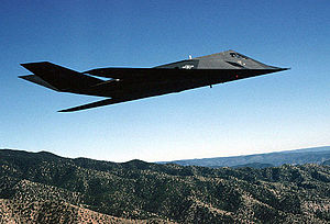 "Air Combat Command - An F-117A Nighthawk Stealth fighter from the 49th Fighter Wing, 9th Fighter Squadron ""Iron Knights,"" from Holloman AFB, New Mexico, flies a training mission over the New Mexico desert"
