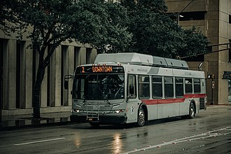 Trinity Metro - Route 2 bus driving towards ITC on a rainy day in downtown Fort Worth.