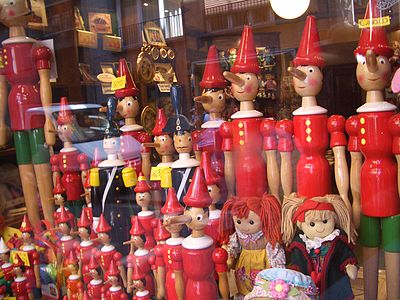 Pinocchio dolls in a shop window in Florence. Photo by Vladimir Menkov. Dual-licensed under the GFDL and CC-By-SA-2.5, 2.0, and 1.0., From WikimediaPhotos