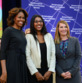 First Lady Michelle Obama and Deputy Secretary Heather Higginbottom with 2014 International Women of Courage Awardee Roshika Deo.png