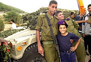 Flickr - Israel Defense Forces - Bedouin Soldier with Schoolchild