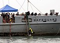 Flickr - Official U.S. Navy Imagery - A Royal Malaysian Navy divers bring up a U.S. Navy diver..jpg