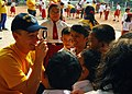 Flickr - Official U.S. Navy Imagery - USS Reuben James Sailor entertains Indonesian children with a magnifying glass.jpg